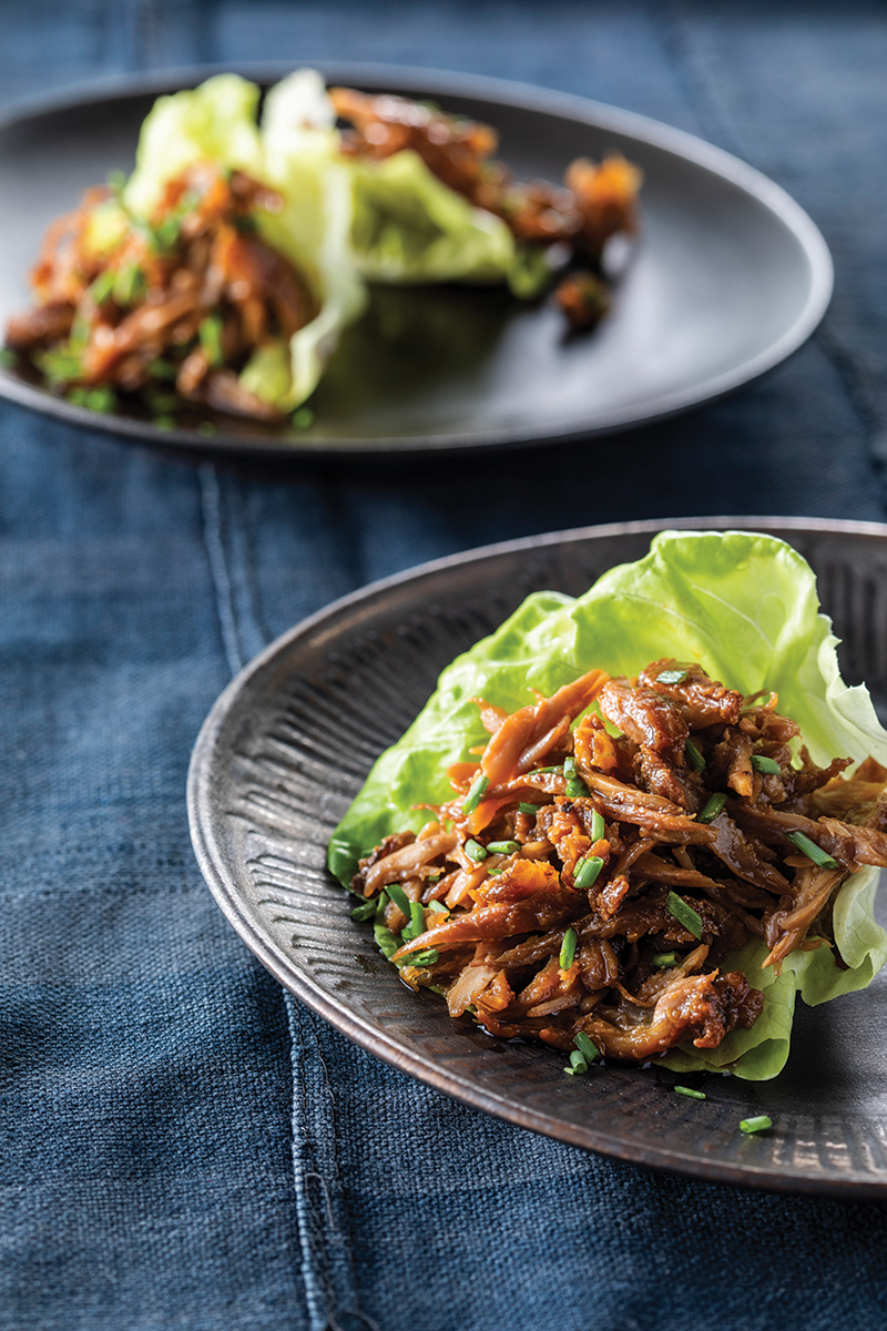 shredded dark meat chicken on lettuce