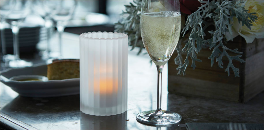 Champaign glass and candle at holiday party