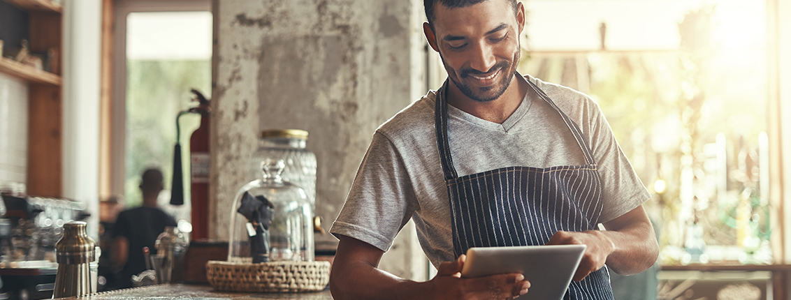 Restaurant owner using tablet