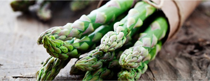 Organic asparagus wrapped in recycled paper